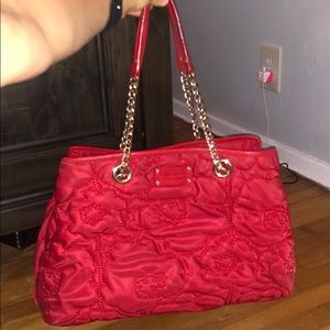 Red Kate spade purse with chain strap